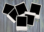 Pile of Blank Photos on Wood Background — Stock Photo