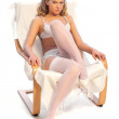 Sexy woman sitting on chair — Stock Photo #1132234