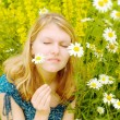 Woman on a meadow with camomiles — Stock Photo