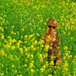 Royalty-Free Stock Photo: Woman in the yellow flowers field