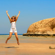 Jumping woman on the seaside — Stock Photo #1579608