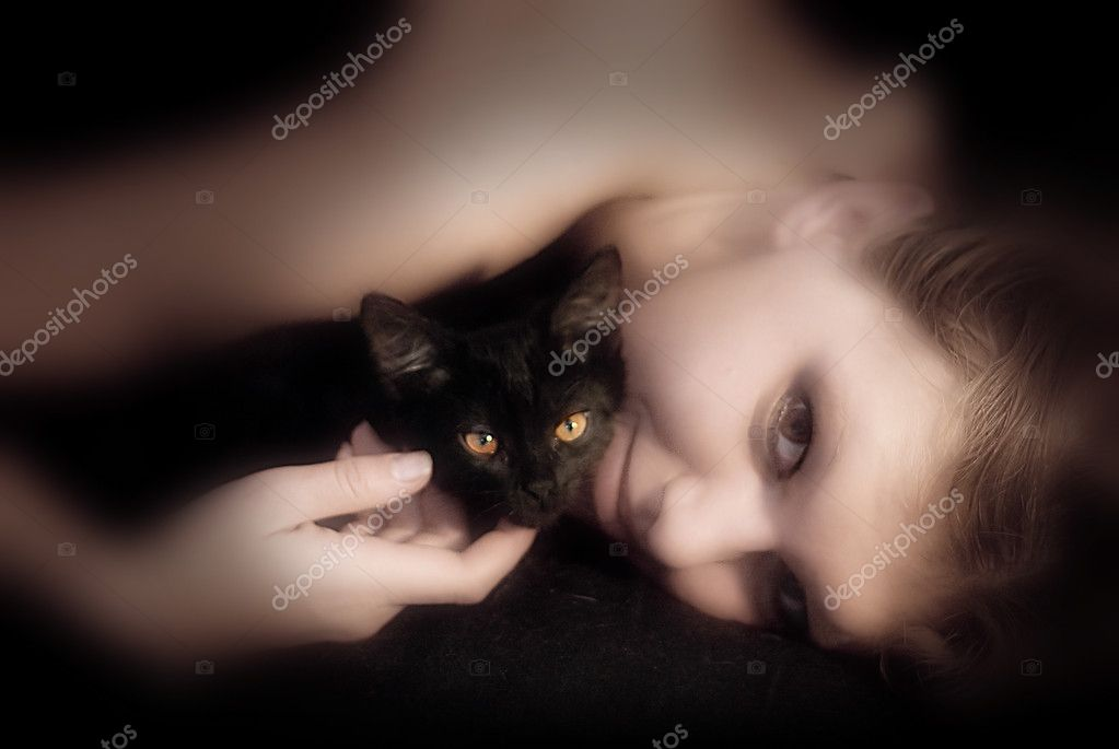 Young woman with the black cat — Stock Photo #1808996