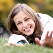 Woman relaxing in the grass - Stockfoto