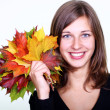 Beautiful young woman and maple leaves — Stock Photo
