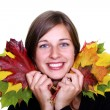 Stock Photo: Beautiful young woman and maple leaves