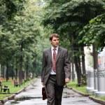Businessman walking on the street — Stock Photo