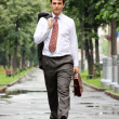 Businessman walking on the street - Stock Photo