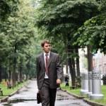 Businessman walking on the street — Stock Photo #1271479