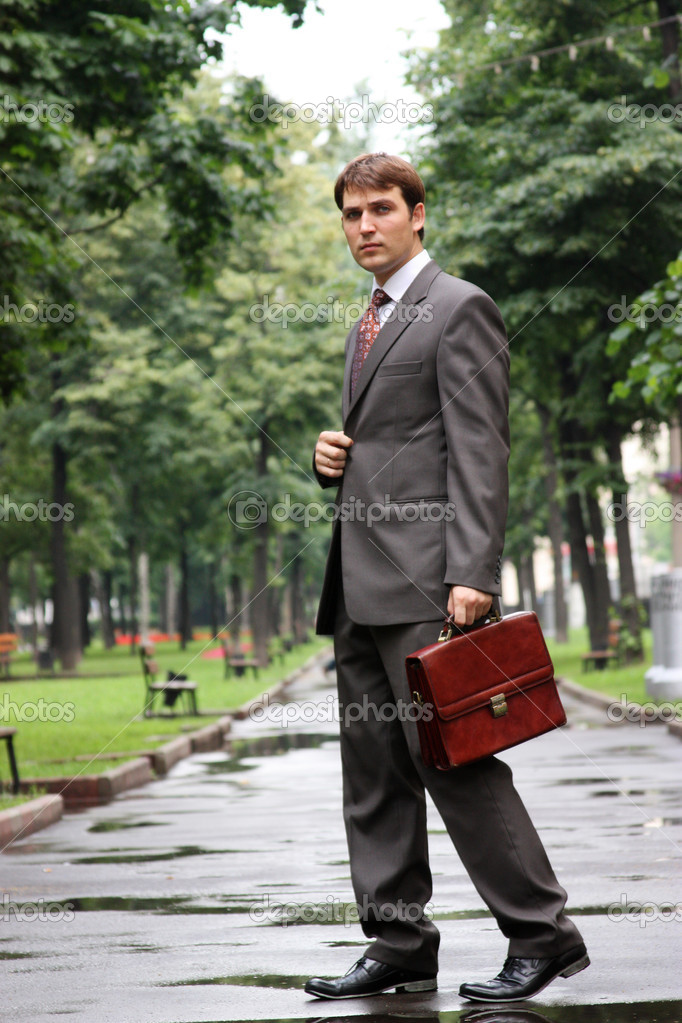 Businessman walking on the street — Stock Photo #1271417