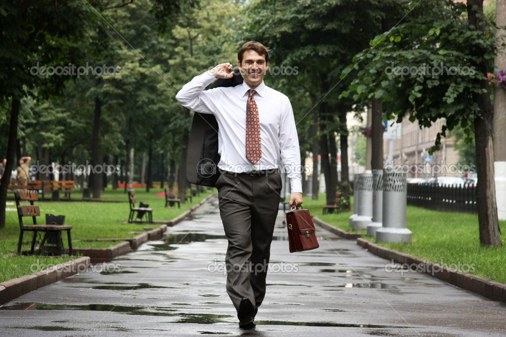 Businessman walking on the street    #1271458