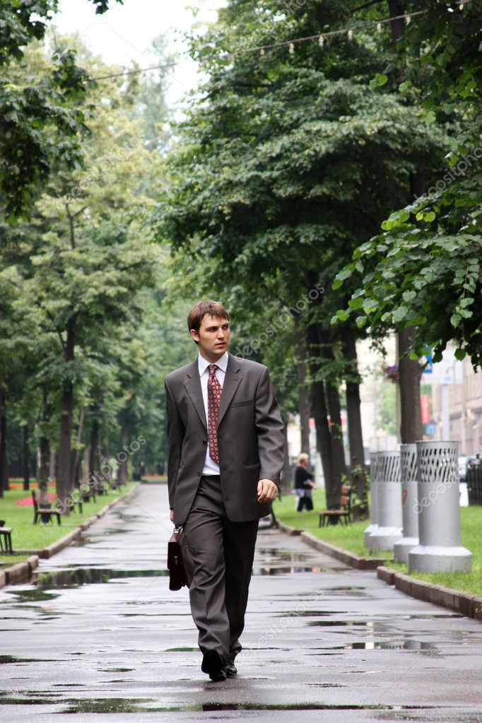 Businessman walking on the street — Stock Photo #1271479