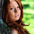 Red-haired girl in summer park — Stock Photo