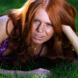 Red-haired girl in summer park — Stok fotoğraf #1294644