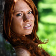 Stok fotoğraf: Red-haired girl in summer park