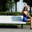 Girl has a rest sitting on a bench in park — Stock Photo #1295959