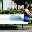 Girl has a rest sitting on a bench in park — Stock Photo