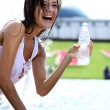 Young woman drinks mineral water — Stock Photo #1296101