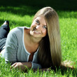 Young woman relaxing in the grass — Stock Photo #1297925