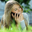 Lady talking on mobile phone - Stock Photo