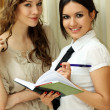 Royalty-Free Stock Photo: Two young women reading books
