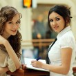 Two young women reading books — Stock Photo