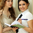 Two young women reading books — Stock Photo #1316177