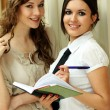 Two young women reading books — Stock Photo #1316220
