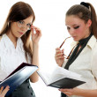 Two young women reading books — Stock Photo #1316532