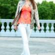 Walking woman in blue jeans — Stock Photo