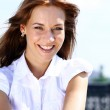 Young woman on outdoor background — Stock Photo