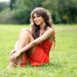 Beautiful young woman relaxing in the grass — Stock Photo #1317722