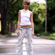 Walking woman in jeans — Foto de Stock