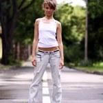 Walking woman in jeans — Stock Photo