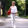 Walking woman in jeans — Stock Photo