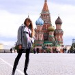Stock Photo: Beautiful young woman next in Red Square, Moscow