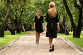 Twins of sister in black dress — Stock Photo