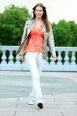 Walking woman in blue jeans — Stock Photo