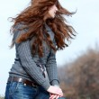 Beautiful young woman in autumnal park — Stock Photo