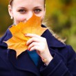 Beautiful young woman in autumn park - 