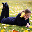 Stock Photo: Young beautiful girl in autumn park