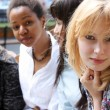 Close-up portrait of four urban women outside — Stock Photo