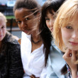 Close-up portrait of four urban women outside — Stock Photo #1324939