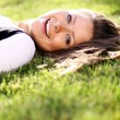 Royalty-Free Stock Photo: Woman  lying on grass field at the park