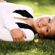 Woman lying on grass field at the park — Stock Photo