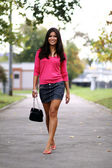 Asian young woman on outdoor background — Stock Photo