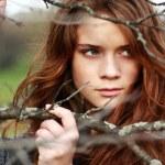 Beautiful woman in autumn park — Stock Photo