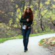 Young woman in autumn park — Stock Photo #2486910