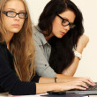 Stock Photo: Business women working with laptop