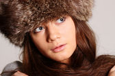 Woman in a furry hat — Stock Photo
