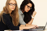 Business women working with laptop — Stock Photo
